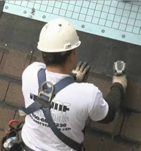 installing-shingles-house-roof