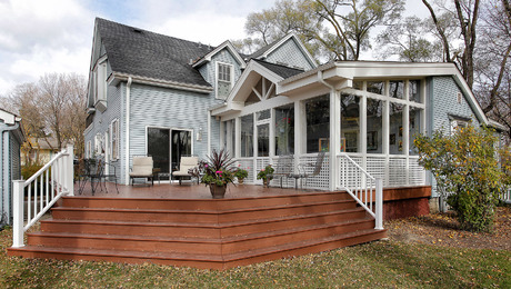 Added a screened in porch to a 1935 farm house. Utilizing a cross gable on a shed roof seemed appropiate for a house with 7 gables already. The wrap around stairs allowed the clients to have unobstructed view of their beautiful yard. PVC decking can be slippery when wet and cold like in the upper midwest.