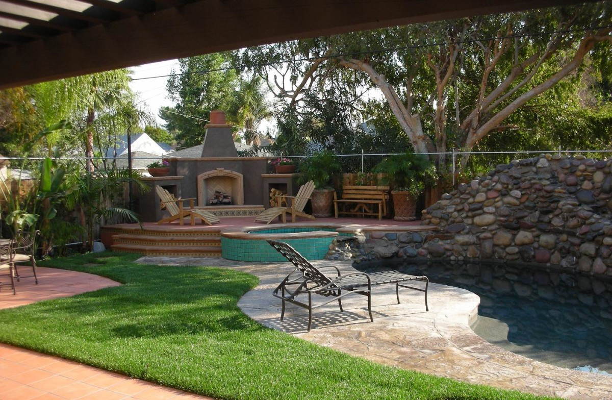 exterior pool side spanish style fireplace fine homebuilding