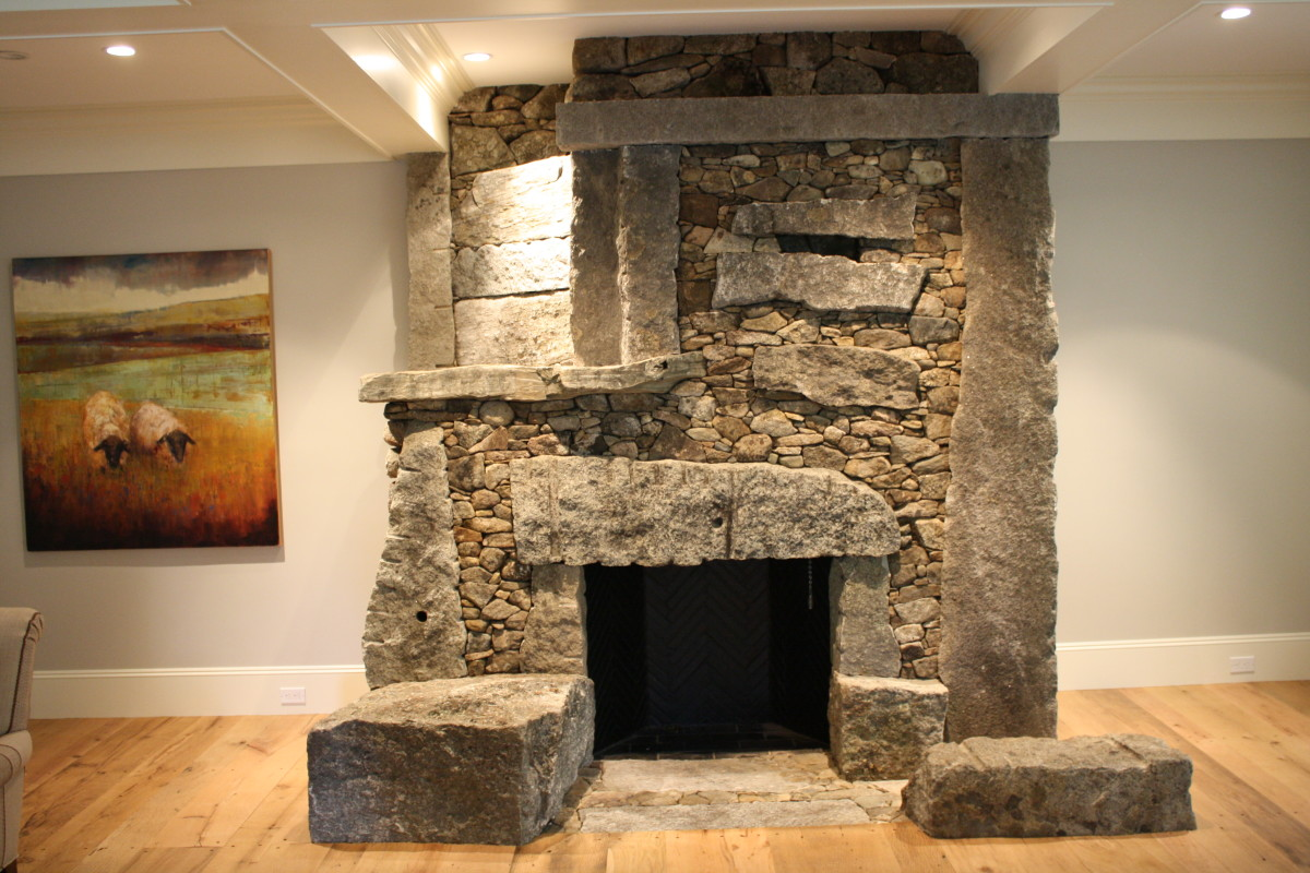 The incredible stonework and art of lew french fine homebuilding - Incredible central fireplace ideas ...