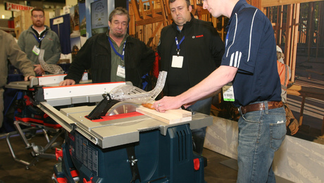 Bosch product manager Craig Wilson uses a hot dog to demonstrate the Bosch REAXX tablesaw's safety system. Like SawStop's finger-saving saws, the Bosch uses the principal of capacitance to trigger an explosive cartridge (like those used in automotive airbags) to force the spinning blade below the table. Unlike SawStop's system, the blade is not damaged by the activation.
