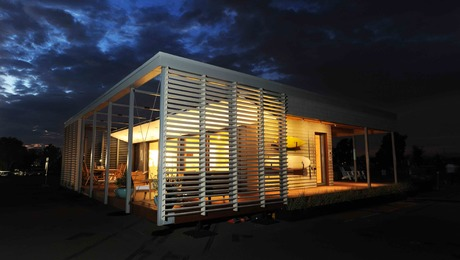 This 1000-sq.-ft. prototype home is designed for tough coastal climate conditions with solar panels that can produce electricity when the grid is down, and integrated exterior shutters that can lock to form a watertight seal against the weather.