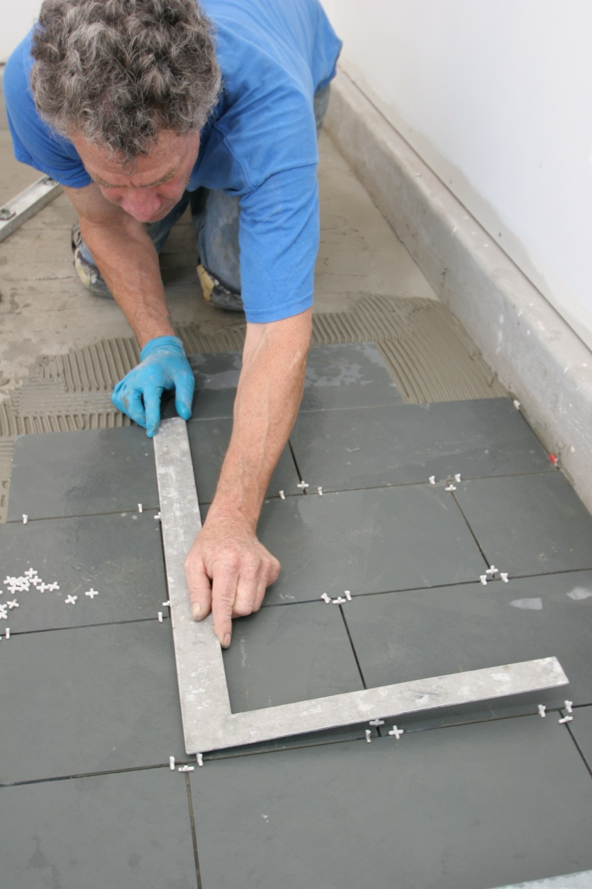 Offsetting tile joints to add visual interest fine homebuilding periodically use a framing square to check make sure end joints line up the white spacers between tiles ensure the correct spacing for the grout dailygadgetfo Choice Image