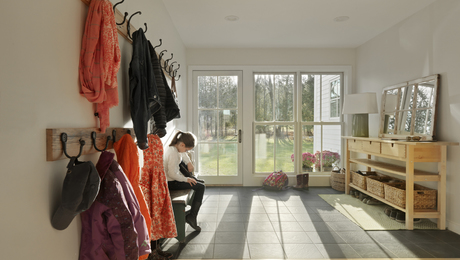 Renovated Farmhouse Mudroom designed by Brian Hamor of Hamor Architecture in Stowe, Vermont