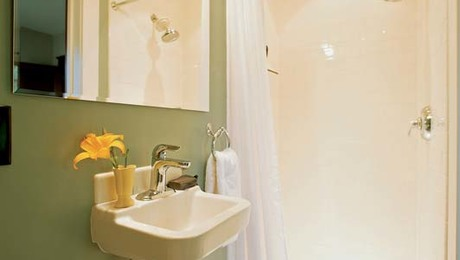Shower Solution #1: A shower stall and small sink turned this space under the stairs into a full-service bathroom.