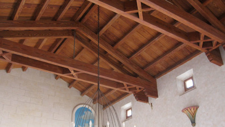 Beautiful exposed ceiling under handmade barrel tile roof.