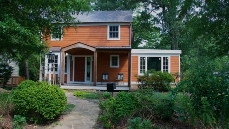 Completed project, recycled content siding, certified wood, make a quirky, delightful exterior.