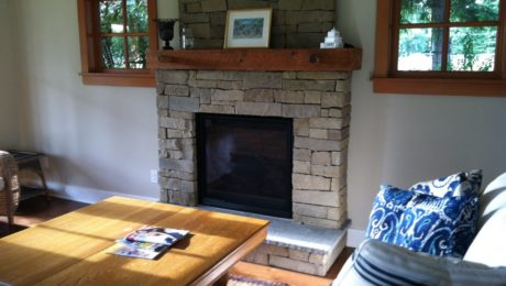 Gas fireplace with dry stack Pennsylvania blue stone hearth and reclaimed wood mantel