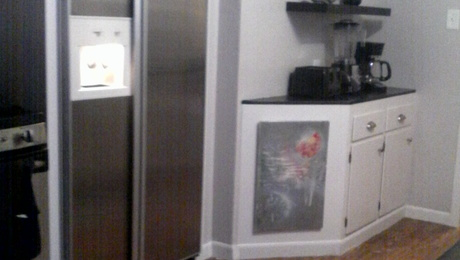 Wall to right is where upper cabinet was removed. Counter depth appliances.