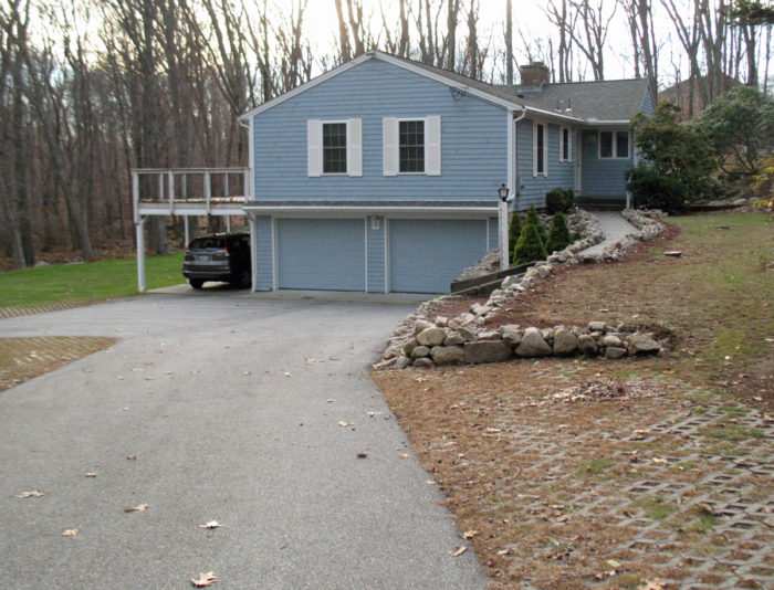 Other houses in the neighborhood have garages below the main living level.