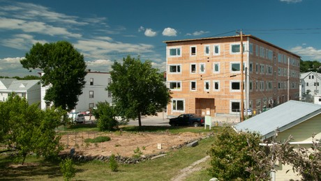 Bayside Anchor is a 45-unit mixed use apartment building under construction in Portland, Maine. It is designed to meet the PHIUS+ 2015 building standard. Across the street is a community garden.