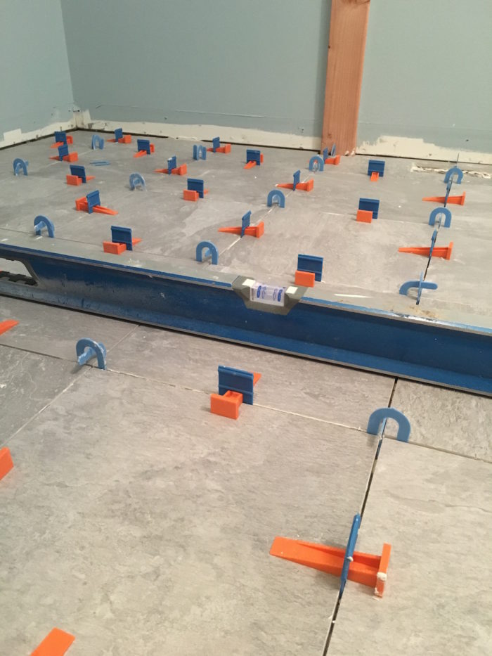 Tile floor leveling system