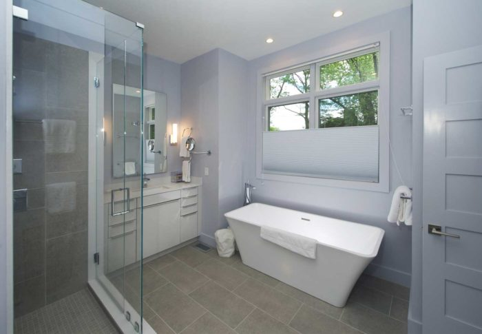 Clean lines define the bathroom's understated elegance.