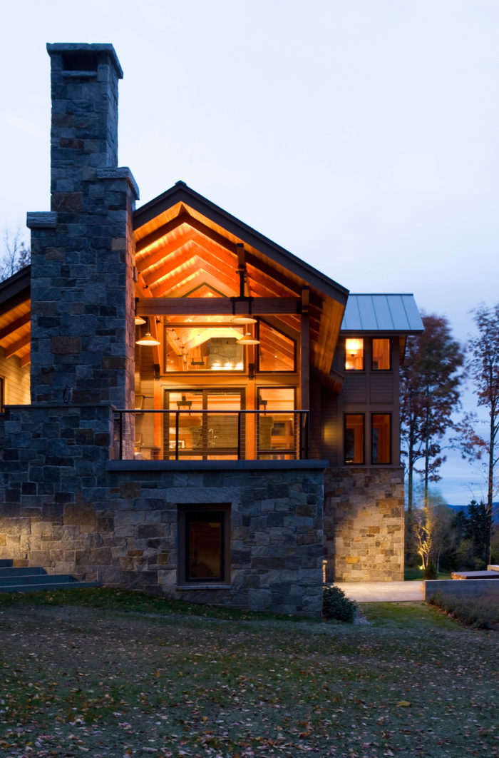 Not to be outdone by the view, the massive stone fireplace brings the modern construction down to earth.