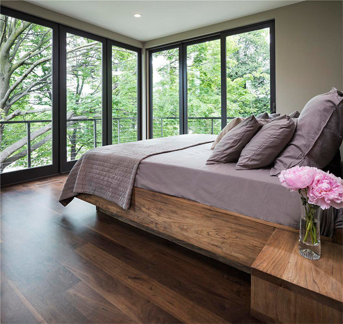 There's no extra ornamentation needed in this modern, moody bedroom.