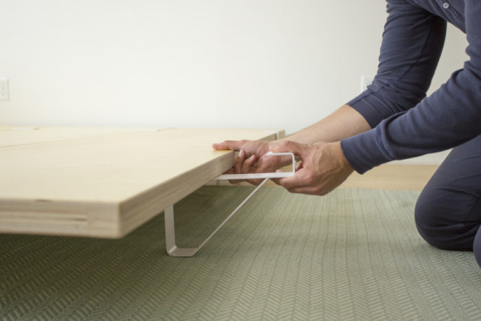 Simply slide the legs onto the finished plywood slabs and cinch everything together with the supplied straps—your hands are the only tools you need
