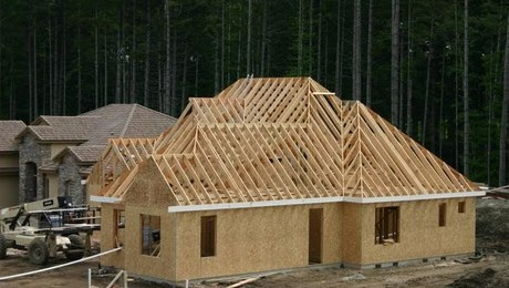 This is a shot of the roof nearly complete. It took us 2 weeks to frame and sheathe. The highest ridge was about 30' off the deck if I remember correctly. The roof was all 12-12 which made it easy to cut. Nearly all of it was calculated on the ground including the broken hips and even the king hip to valley jack(s).