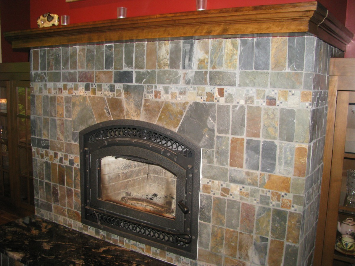 slate fireplace in the style of rookwood pottery fine homebuilding