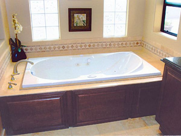 Tubs adding some luxury finehomebuilding for Wood tile tub surround