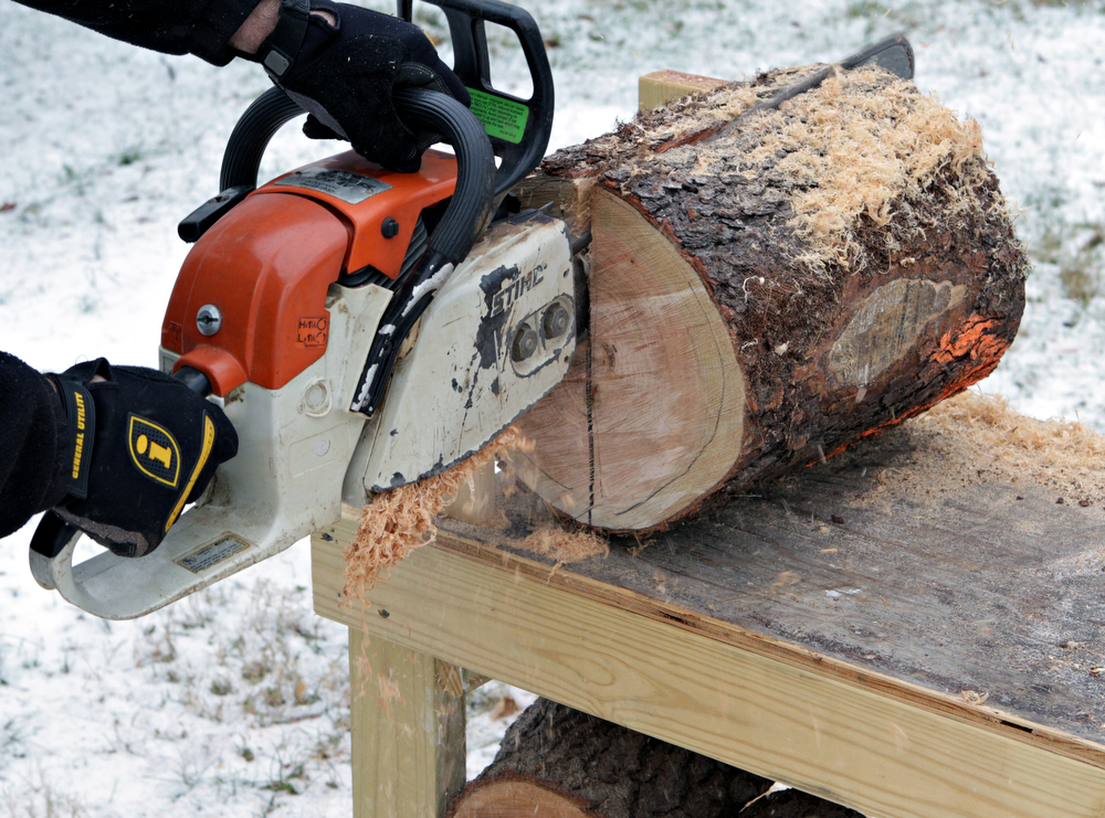 Cutting A Log : Cutting bench makes it easy to convert fresh cut logs into