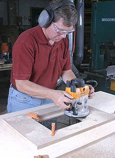 Use a template to rout the opening for the router mounting plate
