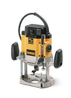Dewalt heavy duty plunge router dw625 finewoodworking with good balance and ergonomics this router handled well i especially liked its slick phenolic baseplate which made it easy to steer the router for edge greentooth Choice Image