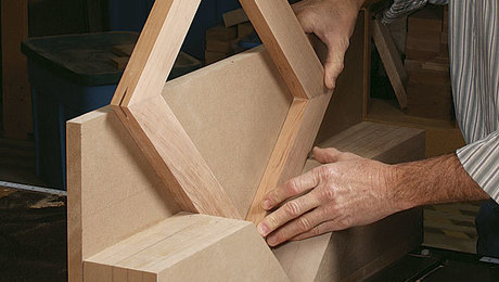Easy splines. The jig holds both frames and boxes safely as you cut clean slots through the corners.Staff