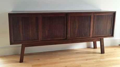 Nakashima inspired walnot credenza with bookmatched top and hand cut dovetails