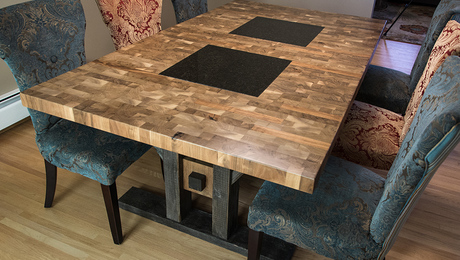 A custom walnut butcher block style dining table with granite inserts and reclaimed wood legs. Regina, Saskatchewan