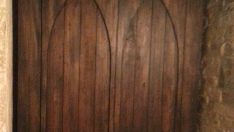 Murphy bed with Gothich arch face.