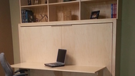Put the bookcase on top of the murphy bed with a folding desk