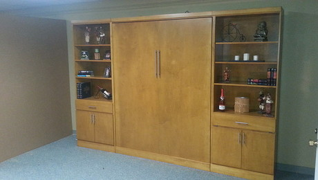 Murphy bed with a pair of wide bookcases