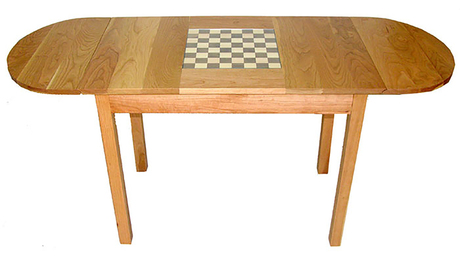 solid cherry wood chess table with walnut and yellow cedar, glass, and only handmade wood hinges and joinery.