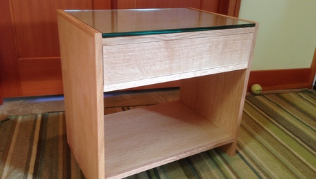 Bedside table in quarter sawn white oak. Custom glass.