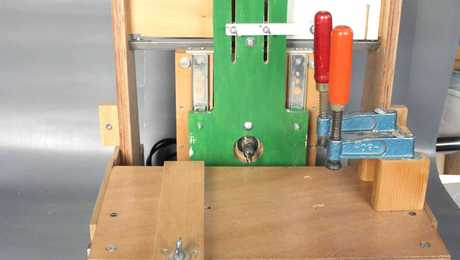 """The frontside with the """"follower"""" and place to set up the template.The table moves forward and backwards by moving the lever."""