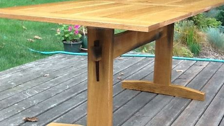 Trestle table from recycled Garry Oak.  Black stains in the trestle supports are from old blacksmith cut nails.