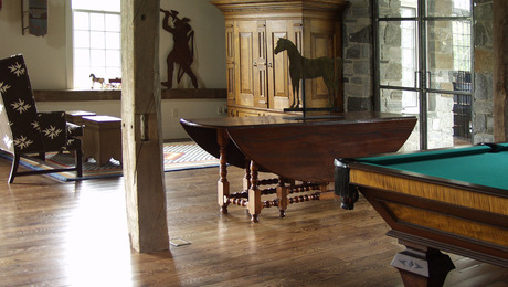 a custom game room, dorset, vt in this photo, we made only the pool table and the large tv kas piece.