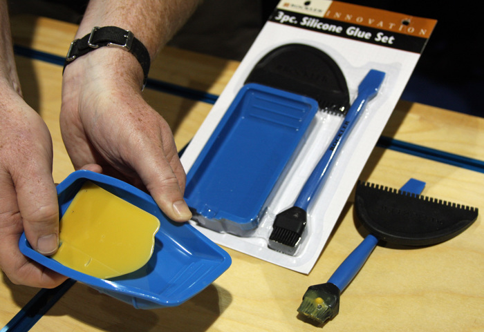 The 3-Piece Silicone Glue Application System includes a tray, brush ...