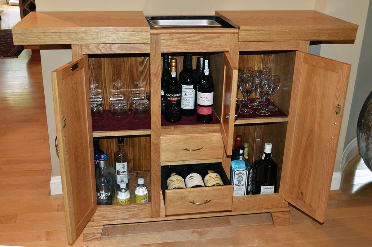 Three Section, Three Drawer Liquor Cabinet In White Oak. Drawers Equipped  With Bottle Holders. Top Opens For Greater Working Area And To Reveal Ice  Bin And ...