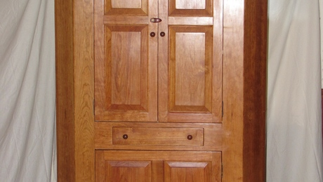 Cherry corner cupboard - front view