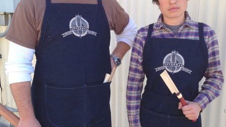 Offerman with shop manager RH Lee, sporting Offerman Woodshop's new denim aprons.