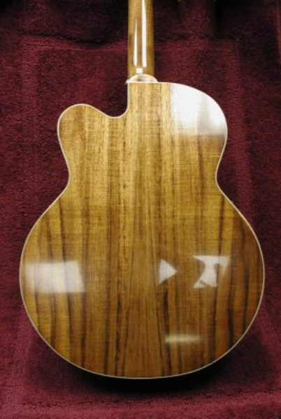 Instrument guitar refinish with chip carved rossette