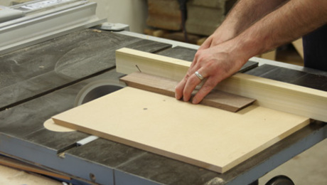 Learn how to build a simple tablesaw sled for more precise miters.
