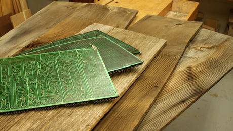 Weathered barn boards from an old tobacco barn and circuit panels used for materials
