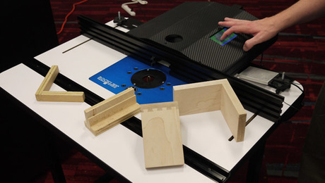 """The """"Ready to Rout"""" computer-controlled router table fence system."""