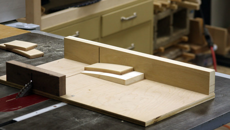 The solution. It's actually simple. Just a cradle that's curved on the top to match the curve of the drawer fronts.