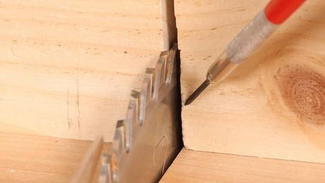 This crosscut sled's blade opening is worn and gappy. This results in tearout and makes the kerf unreliable for aligning a cut with the blade.