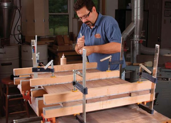 To prevent the cauls from sticking to glue squeezeout  apply packing or  duct tape to the contact faces  Elevate the boards off the bench and clamp  the cauls. Clamping cauls  The secret to great glue ups   FineWoodworking