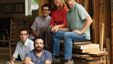 Boggs, right, with his partner, Melanie Moeller, and the Asheville members of The Boggs Collective.