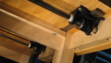 Hovarter bench vise mechanism has smooth, fast acting motion.  Transfer bar synchronizes clamps.